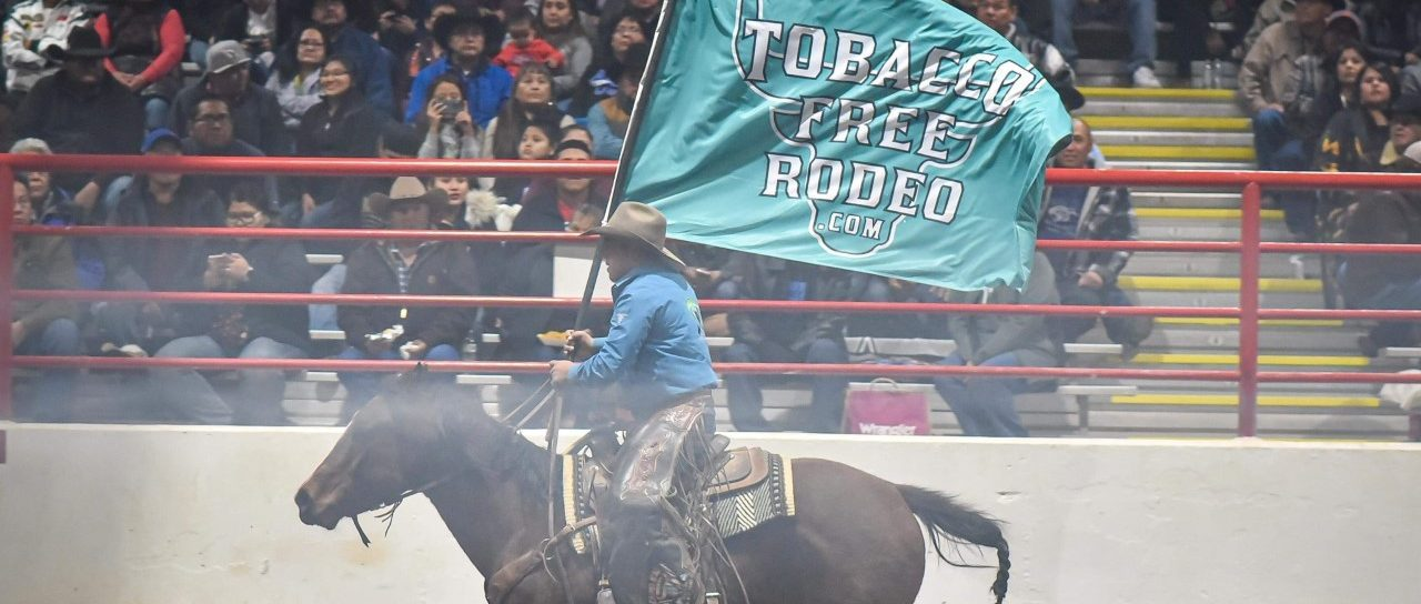 Rider carrying flag photo