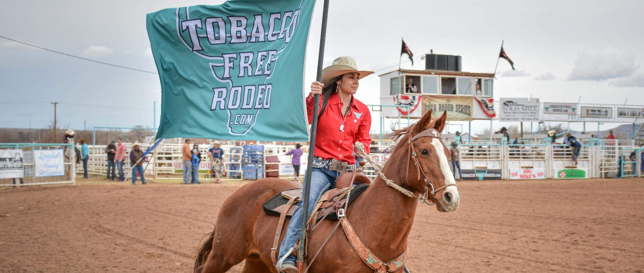 woman riding horse with flag